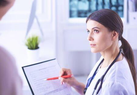 Beautiful female doctor explaining medical treatment to a patient Reklamní fotografie