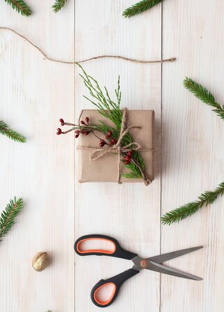 Christmas gift boxes and fir tree branch on wooden table, flat lay. Ð¡hristmas background