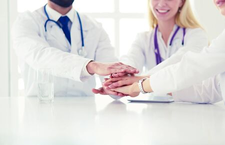Team of doctors putting hands together, closeup Imagens