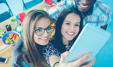 Group of people doing selfie during lunch. Self. Friends. Friends are photographed for eating Stock Photo