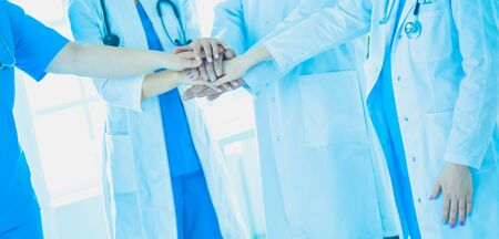 Group of doctors putting their hands together. Close-up Imagens