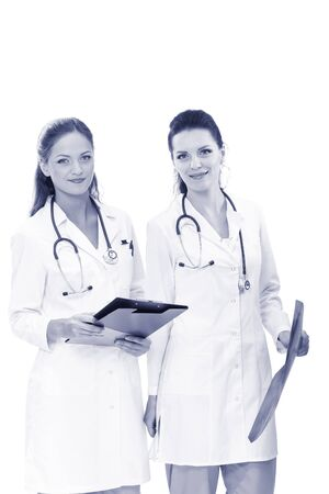 Two woman nurse watching X Ray image, standing in hospital. X Ray . Two woman doctor.