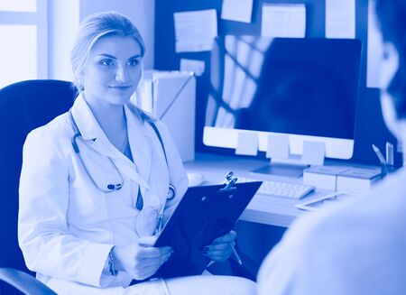 Woman doctor explaining diagnosis to her female patient
