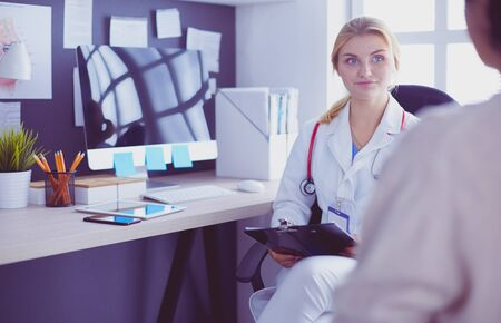 Woman doctor explaining diagnosis to her female patient 写真素材