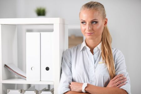 Modern business woman standing in the office
