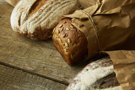 Composition of various breads, on wooden background Stockfoto