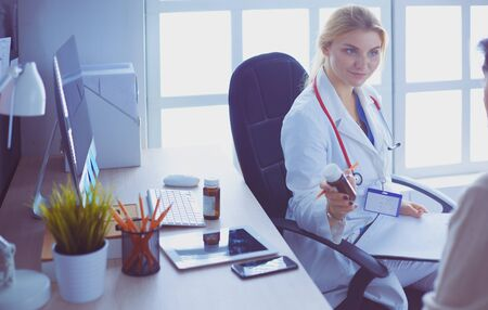 A doctor is talking and examining a patient Stock Photo