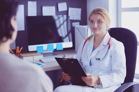 Woman doctor explaining diagnosis to her female patient Stock Photo