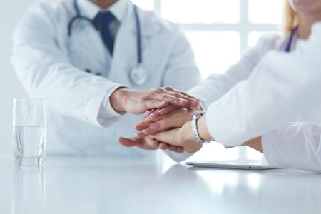 Doctor shaking hands with a male patient in the office.