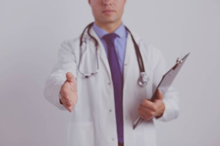 Friendly male doctor with open hand ready for hugging.