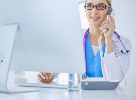 Portrait of female doctor using his mobile phone in the office