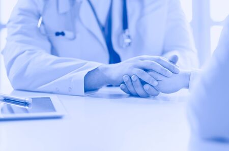 Close-up of stethoscope and paper on background of doctor and patient hands Banco de Imagens