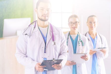 Group of doctors and nurses standing in the hospital room Stock Photo