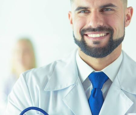 Young and confident male doctor portrait. Successful doctor career concept