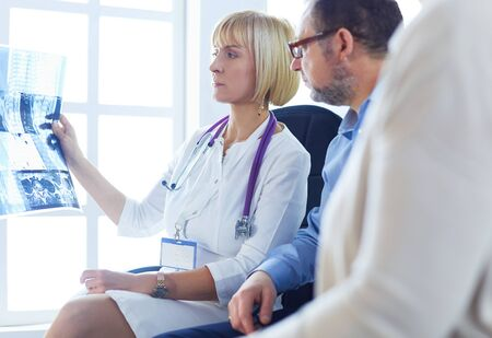 Doctor woman explaining x-ray results to patient