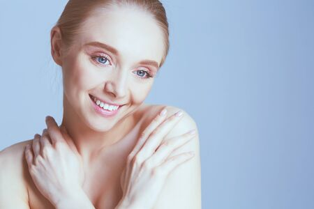 Adult woman portrait, skin care concept, beautiful skin and hands