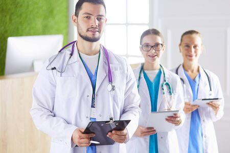 Group of doctors and nurses standing in the hospital room