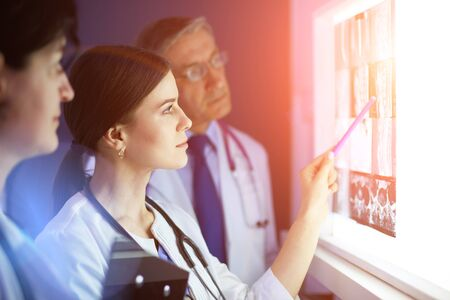 Group of doctors in a hospital. X-ray diagnostics. Stock Photo