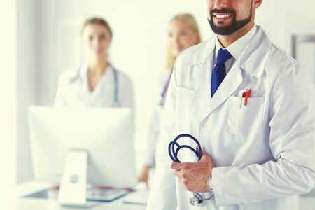 Young male doctor in front of medical group.