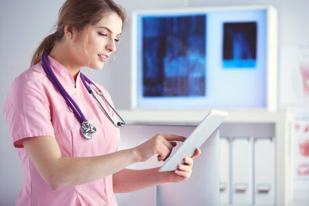 Doctor woman checking medical data on tablet pc