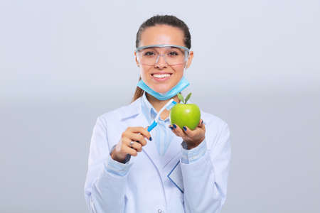 Dentist medical doctor woman hold green fresh apple in hand and tooth brush. Dentist doctors. Woman doctors