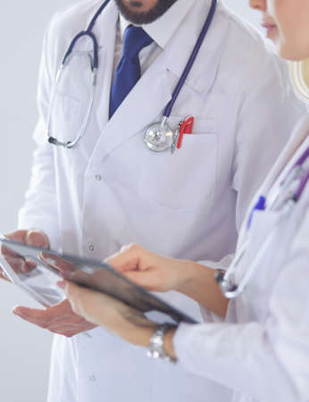 Two doctors holding a folder and talking about patient Zdjęcie Seryjne