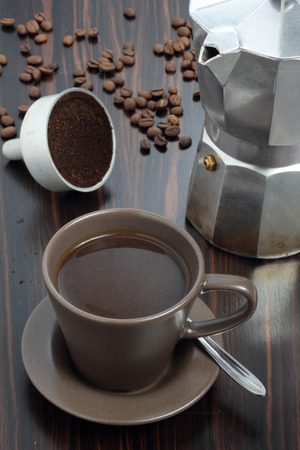 stovetop: Stovetop coffee maker filter, cup of coffee and filter.