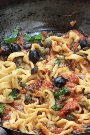 freshly cooked: Pan of freshly cooked beautiful fettuccine puttanesca.