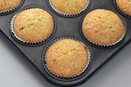 undecorated: Baked vanilla cupcakes sprinkled with white sugar.