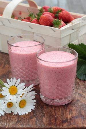 freshly prepared: Two glasses of freshly prepared, delicious strawberry milkshake. Stock Photo