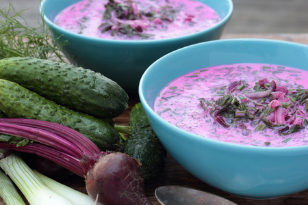 polish lithuanian: Closeup of a bowl of cold beetroot soup.