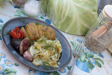 concertina: Closeup of cooked cabbage and roasted concertina potato. Stock Photo