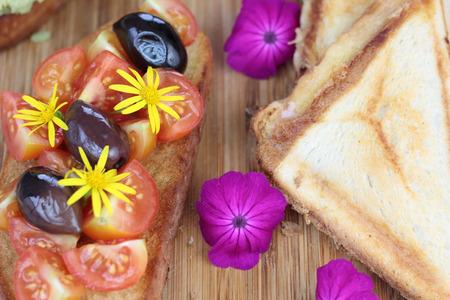 kalamata: Cherry tomatoes and kalamata olives on toast. Stock Photo