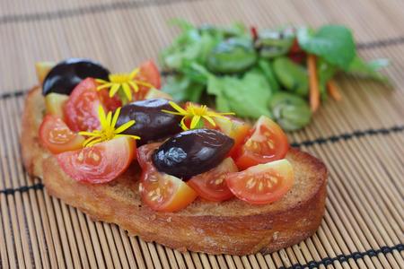 kalamata: Fresh cherry tomatoes and kalamata olives on toast.