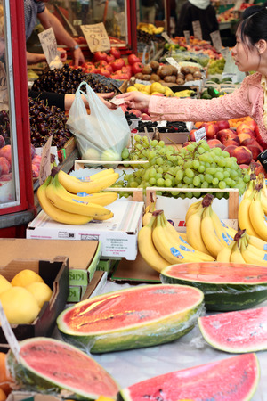 fruit trade: The woman pays for vegetables and fruits. Market in Gdynia.