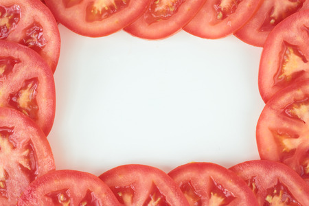 tomato slices: Tomato slices formed in an isolated food frame. Stock Photo