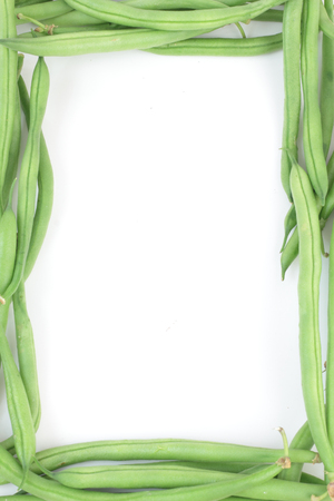 regimen: Bunch of fresh green beans formed in a frame, isolated on white.