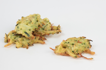 courgette: Deepfried courgette cakes. Cooked to perfection.