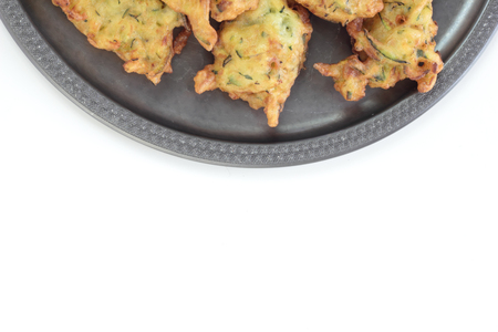 vegetable tin: Deepfried courgette cakes, served on a tin plate. Stock Photo