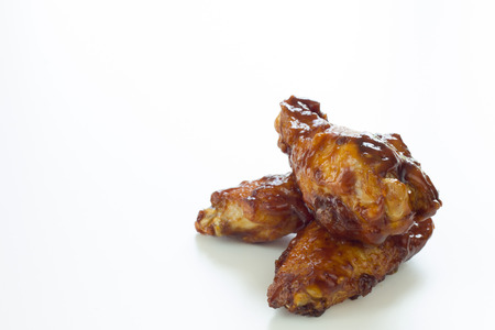 bbq chicken: Three fried chicken wings isolated on white. Stock Photo
