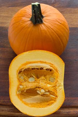 timber cutting: Closeup of pumpkins on a timber cutting board.