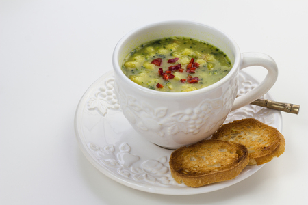 food ingredient: Quick broccoli soup with chili and toasted slices of roll.