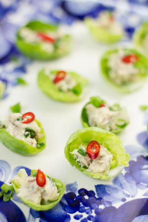 Brussels sprouts stuffed with mackerel pate, chives and chili. Stock Photo
