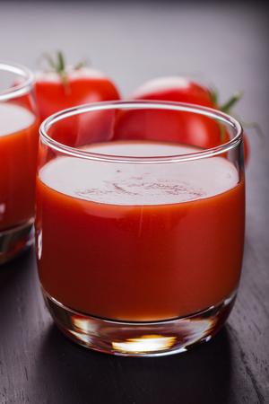 freshly prepared: Glass full of freshly prepared tomat juice. Stock Photo