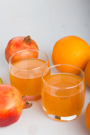 pomme: Glass of orange and basil seeds drink.