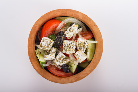 greek pot: Greek salad in a clay pot isolated on white.