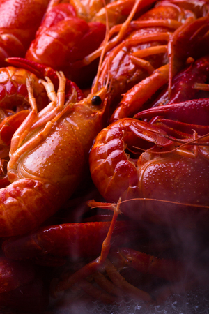 defrost: Crayfish are being cooked on a frying pan.