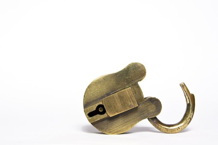 old brass padlock isolated on a white background