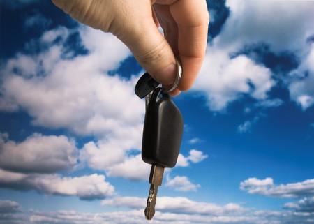 car keys against cloudy blue sky Stock Photo