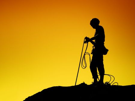 abseiling: Rock Climber Silhouette